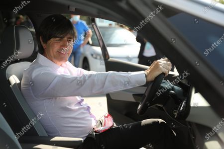 National coach Joachim Löw picks up his electric Volkswagen ID.3 from the Center of Future Mobility