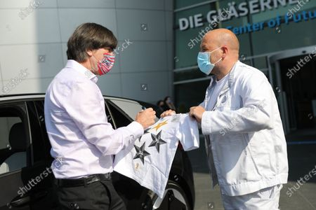 Stock Image of National coach Joachim Löw picks up his electric Volkswagen ID.3 from the Center of Future Mobility
