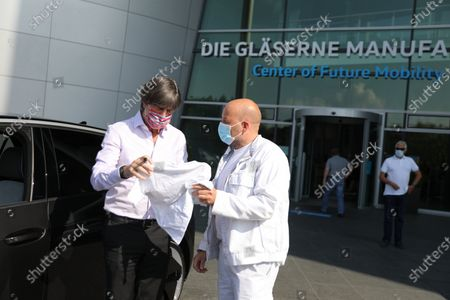 Stock Picture of National coach Joachim Löw picks up his electric Volkswagen ID.3 from the Center of Future Mobility