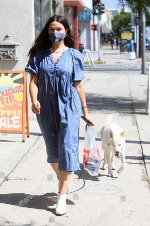 Stock Picture of Crystal Reed is seen walking her dog down the street.