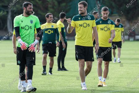 Sporting CP goalkeeper Antonio Adan (L) talks with teammate Sebastian Coates (C) during a training session in Lagos, Southern of Portugal, 23 September 2020. Sporting CP will face Aberdeen in thei UEFA Europa League third qualifying round soccer match on 24 September 2020.