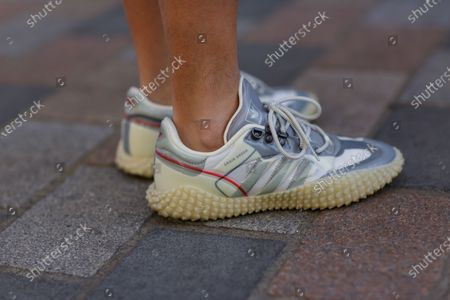 Stock Image of Delcan Chan wearing Craig Green x Adidas