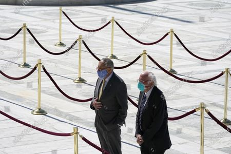 Stock fotografie na téma Senate Minority Leader Chuck Schumer, D-N.Y., and Sen. Bernie Sanders, I-Vt., pay respects as Justice Ruth Bader Ginsburg lies in repose under the Portico at the top of the front steps of the U.S. Supreme Court building, in Washington. Ginsburg, 87, died of cancer on Sept. 18