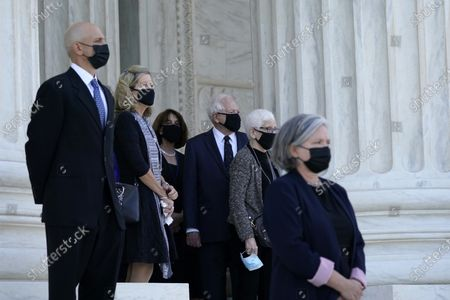 Former President Jimmy Carter, center, watches as the flag-draped casket of Justice Ruth Bader Ginsburg arrives at the Supreme Court in Washington, . Ginsburg, 87, died of cancer on Sept. 18