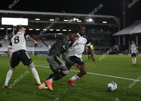 Fisayo Dele-Bashiru of Sheffield Wednesday charges past Stefan Johansen and Josh Onomah of Fulham; Craven Cottage, London, England; English Football League Cup, Carabao Cup Football, Fulham versus Sheffield Wednesday.