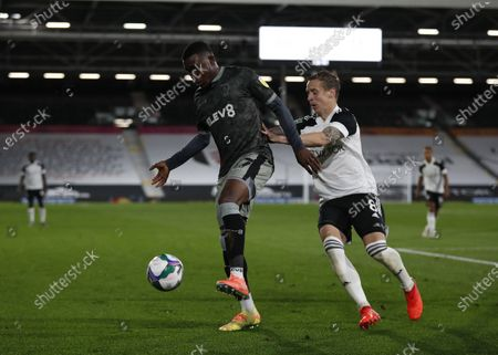 Stefan Johansen of Fulham marking Fisayo Dele-Bashiru of Sheffield Wednesday; Craven Cottage, London, England; English Football League Cup, Carabao Cup Football, Fulham versus Sheffield Wednesday.
