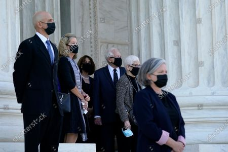 Stock Picture of CORRECTION - CORRECTS TO REMOVE REFERENCE TO JIMMY CARTER - People watch as the flag-draped casket of Justice Ruth Bader Ginsburg arrives at the Supreme Court in Washington,. Ginsburg, 87, died of cancer on Sept. 18.