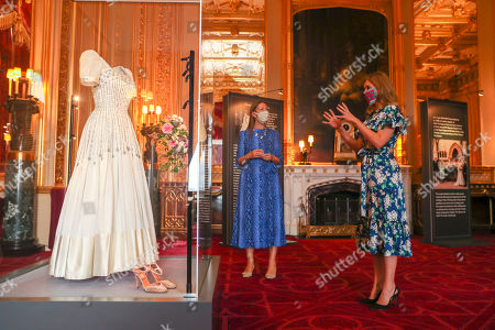 Princess Beatrice alongside her wedding dress, talks with Royal Collection Trust curator Caroline de Guitut, ahead of it going on public display at Windsor Castle from Thursday. The Sir Norman Hartnell gown, first worn by the Queen in the 1960s, was loaned to Beatrice by her grandmother for her secret, low-key wedding to Edoardo Mapelli Mozzi in July.