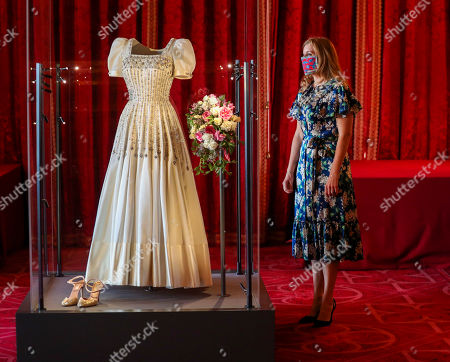 Princess Beatrice alongside her wedding dress, ahead of it going on public display at Windsor Castle from Thursday. The Sir Norman Hartnell gown, first worn by the Queen in the 1960s, was loaned to Beatrice by her grandmother for her secret, low-key wedding to Edoardo Mapelli Mozzi in July.