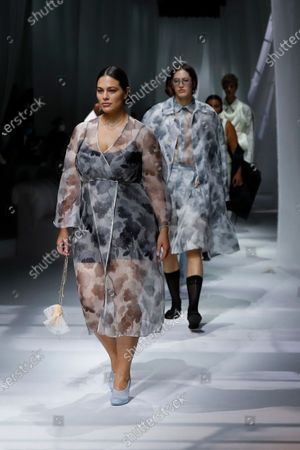 Model Ashley Graham wears a creation as part of the Fendi 2021 women's spring-summer ready-to-wear collection during the Milan's fashion week in Milan, Italy