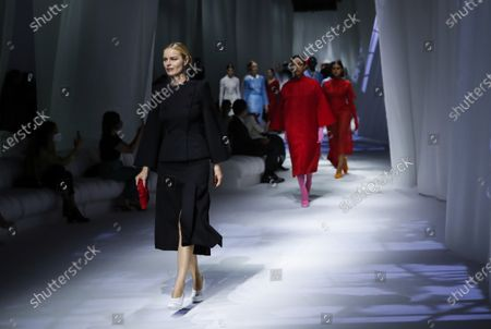 Stock Photo of Model Eva Herzigova wears a creation as part of the Fendi 2021 women's spring-summer ready-to-wear collection during the Milan's fashion week in Milan, Italy