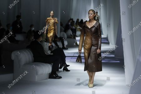 Stock Photo of Model Yasmin Le Bon wears a creation as part of the Fendi 2021 women's spring-summer ready-to-wear collection during the Milan's fashion week in Milan, Italy