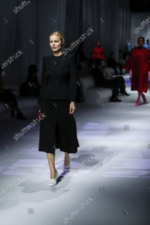 Model Eva Herzigova wears a creation as part of the Fendi 2021 women's spring-summer ready-to-wear collection during the Milan's fashion week in Milan, Italy