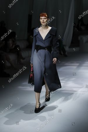 Model Karen Elson wears a creation as part of the Fendi 2021 women's spring-summer ready-to-wear collection during the Milan's fashion week in Milan, Italy