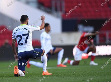 Ahmed Elmohamady of Aston Villa kneels against racism before kick off; Ashton Gate Stadium, Bristol, England; English Football League Cup, Carabao Cup Football, Bristol City versus Aston Villa.