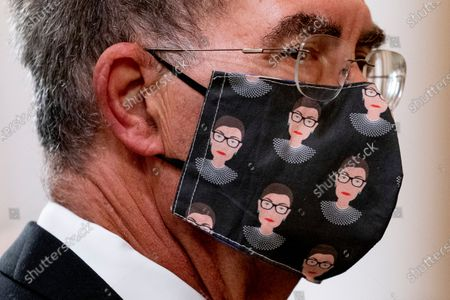 Stock Photo of David Reines, the husband of NPR Supreme Court reporter Nina Totenberg wears a face mask with depictions of Justice Ruth Bader Ginsburg on it during a private ceremony for Justice Ruth Bader Ginsburg at the Supreme Court in Washington, . Ginsburg, 87, died of cancer on Sept. 18