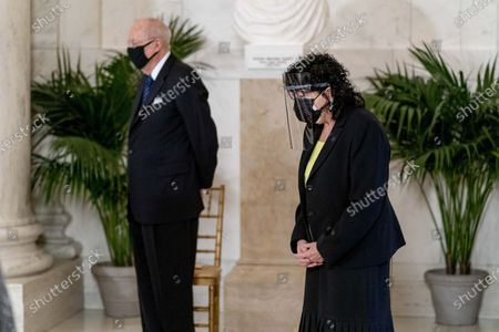 Retired Justice Anthony Kennedy, left, and Justice Sonia Sotomayor, right, stand during a private ceremony for Justice Ruth Bader Ginsburg at the Supreme Court in Washington, . Ginsburg, 87, died of cancer on Sept. 18