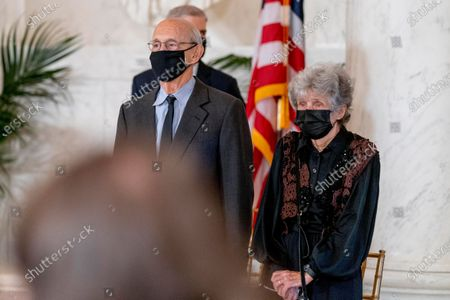 Justice Stephen Breyer and his wife Joanna stand during a private ceremony for Justice Ruth Bader Ginsburg at the Supreme Court in Washington, . Ginsburg, 87, died of cancer on Sept. 18