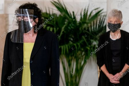 Justice Sonia Sotomayor, left, and Maureen Scalia, the wife of the late Justice Antonin Scalia, right, stand during a private ceremony for Justice Ruth Bader Ginsburg at the Supreme Court in Washington, . Ginsburg, 87, died of cancer on Sept. 18