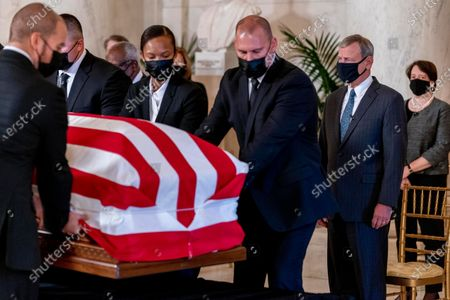 Chief Justice of the United States John Roberts, second from right, and Justice Elena Kagan, right, watch as the flag-draped casket of Justice Ruth Bader Ginsburg arrives at the Supreme Court in Washington, . Ginsburg, 87, died of cancer on Sept. 18. At far right is Associate Justice Elena Kagan