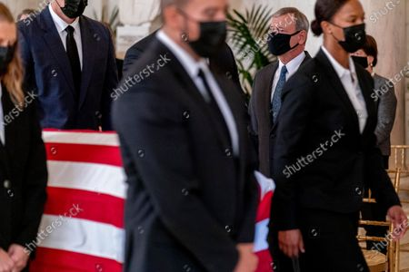 Chief Justice of the United States John Roberts stands as the flag-draped casket of Justice Ruth Bader Ginsburg arrives at the Supreme Court in Washington, . Ginsburg, 87, died of cancer on Sept. 18