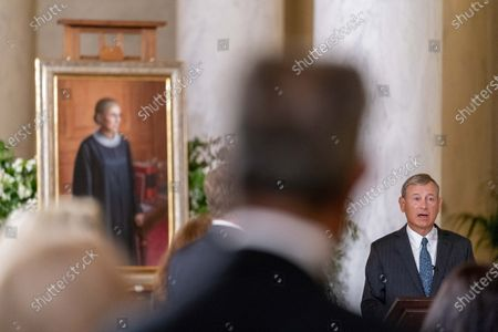 Chief Justice of the United States John Roberts speaks in front of a 2016 portrait of Justice Ruth Bader Ginsburg by artist Constance P. Beaty during a private ceremony at the Supreme Court in Washington, . Ginsburg, 87, died of cancer on Sept. 18