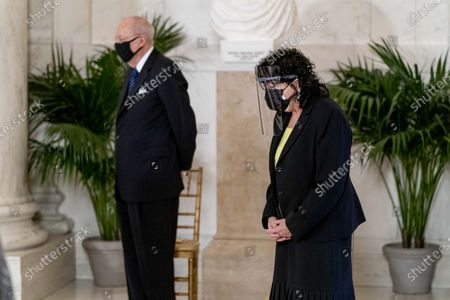 Retired Justice Anthony Kennedy, left, and Justice Sonia Sotomayor, right, stand during a private ceremony for Justice Ruth Bader Ginsburg at the Supreme Court in Washington,. Ginsburg, 87, died of cancer on Sept. 18.