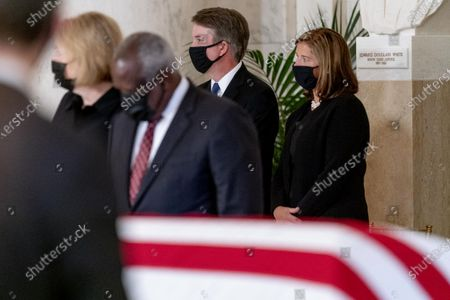 From left, Virginia Thomas, her husband Justice Clarence Thomas, Justice Brett Kavanaugh and his wife Ashley Kavanaugh, stand during a private ceremony for Justice Ruth Bader Ginsburg at the Supreme Court in Washington,. Ginsburg, 87, died of cancer on Sept. 18.
