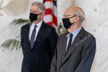 Stock Photo of Justice Neil Gorsuch, left, and Justice Stephen Breyer, right, stand during a private ceremony for Justice Ruth Bader Ginsburg at the Supreme Court in Washington,. Ginsburg, 87, died of cancer on Sept. 18.