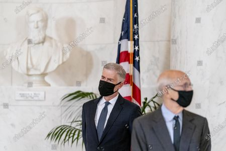 Stock Image of Justice Neil Gorsuch, left, and Justice Stephen Breyer, right, stand during a private ceremony for Justice Ruth Bader Ginsburg at the Supreme Court in Washington,. Ginsburg, 87, died of cancer on Sept. 18.