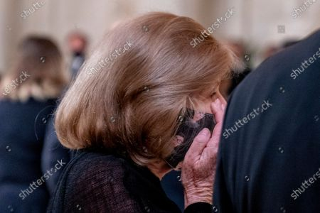 Stock Image of NPR Supreme Court reporter Nina Totenberg wears a face mask with depictions of Justice Ruth Bader Ginsburg on it as she wipes her eye as the flag-draped casket of Justice Ruth Bader Ginsburg arrives at the Supreme Court in Washington,. Ginsburg, 87, died of cancer on Sept. 18.