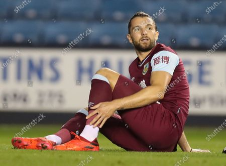 Jay Rodriguez of Burnley holds his ankle before going off injured in the 1st half