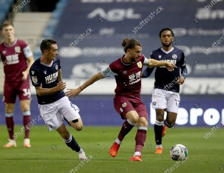 Jay Rodriguez of Burnely gets away from Shaun Williams of Millwall