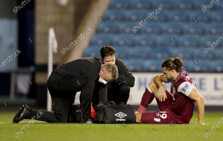 Jay Rodriguez of Burnley is treated by the physios before going off injured in the 1st half