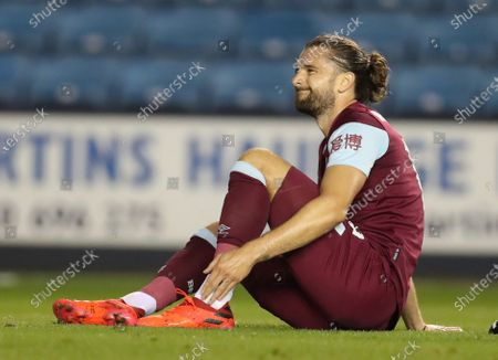 Jay Rodriguez of Burnley holds his injured ankle