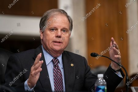 Senator Doug Jones (D-AL) asks a question during a US Senate Senate Health, Education, Labor, and Pensions Committee Hearing to examine COVID-19, focusing on an update on the federal response at the US Capitol in Washington, DC, USA, 23 September 2020.