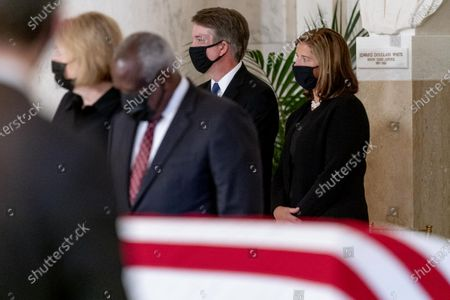 From left, Virginia Thomas, her husband Justice Clarence Thomas, Justice Brett Kavanaugh and his wife Ashley Kavanaugh, stand during a private ceremony for Justice Ruth Bader Ginsburg at the Supreme Court in Washington, DC, USA, 23 September 2020. Ginsburg, 87, died of cancer on 18 Setpember.