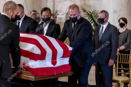 Chief Justice of the United States John Roberts, second from right, and Justice Elena Kagan, right, watch as the flag-draped casket of Justice Ruth Bader Ginsburg arrives at the Supreme Court in Washington, DC, USA, 23 September 2020. Ginsburg, 87, died of cancer on 18 Setpember. At far right is Associate Justice Elena Kagan.