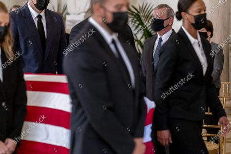 Chief Justice of the United States John Roberts stands as the flag-draped casket of Justice Ruth Bader Ginsburg arrives at the Supreme Court in Washington, DC, USA, 23 September 2020. Ginsburg, 87, died of cancer on 18 Setpember.