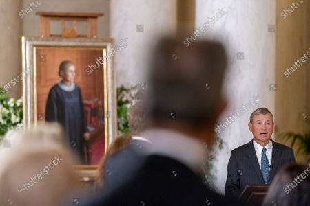 Chief Justice of the United States John Roberts speaks in front of a 2016 portrait of Justice Ruth Bader Ginsburg by artist Constance P. Beaty during a private ceremony at the Supreme Court in Washington, DC, USA, 23 September 2020. Ginsburg, 87, died of cancer on 18 Setpember.