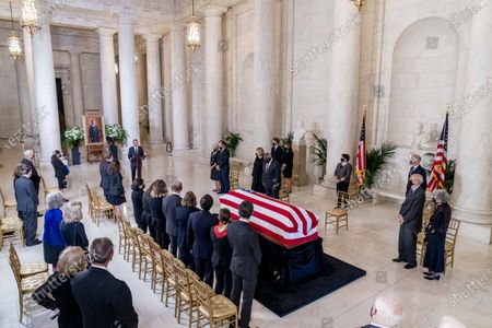The flag-draped casket of Justice Ruth Bader Ginsburg is visible as Chief Justice of the United States John Roberts speaks during a private ceremony at the Supreme Court in Washington, DC, USA, 23 September 2020. Ginsburg, 87, died of cancer on 18 Setpember.