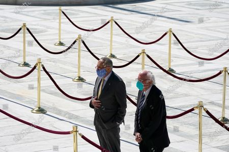 Senate Minority Leader Chuck Schumer, D-N.Y., and Sen. Bernie Sanders, I-Vt., pay respects as Justice Ruth Bader Ginsburg lies in repose under the Portico at the top of the front steps of the US Supreme Court building in Washington, DC, USA, 23 September 2020. Thousands of mourners are expected to pay their respects to Justice Ginsburg, who will lay in repose outside the high court for two days.