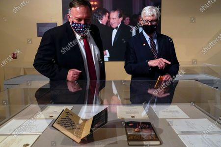 Secretary of State Mike Pompeo, left, tours an exhibit featuring letters written between Donald Trump and Richard Nixon at the Richard Nixon Presidential Library with Hugh Hewitt, president and CEO of the Nixon Foundation, in Yorba Linda, Calif