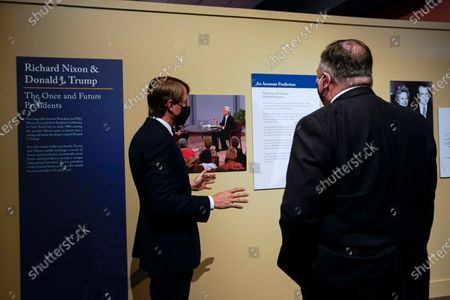 Secretary of State Mike Pompeo, right, tours an exhibit featuring letters written between Donald Trump and Richard Nixon at the Richard Nixon Presidential Library with Christopher Nixon Cox, left, grandson of former U.S. president Richard Nixon, in Yorba Linda, Calif