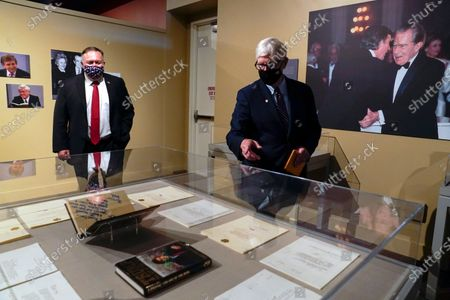 Secretary of State Mike Pompeo, left, tours an exhibit featuring letters written between Donald Trump and Richard Nixon at the Richard Nixon Presidential Library with Hugh Hewitt, president and CEO of the Nixon Foundation in Yorba Linda, Calif