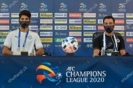 Stock Image of Xavi Hernandez (R), head coach of Al Sadd, and player Mohammed Waad Albayati attend a press conference ahead of AFC Champions League Grounp D match between Al Sadd of Qatar and Sepahan FC of Iran in Doha, capital of Qatar, Sept. 23, 2020.