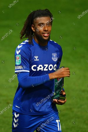 Alex Iwobi of Everton with his Carabao branded man of the match trophy