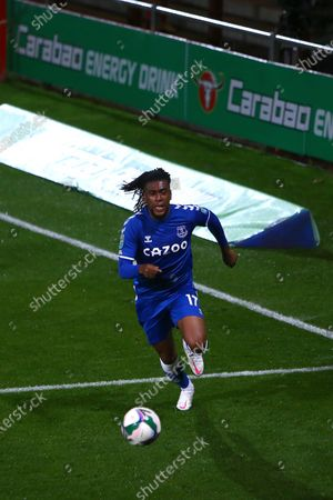 Alex Iwobi of Everton in front of Carabao ad board and 3D pitch mat