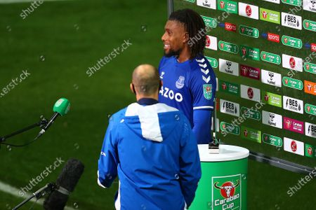 Alex Iwobi of Everton interviewed for TV in front of the Carabao branding
