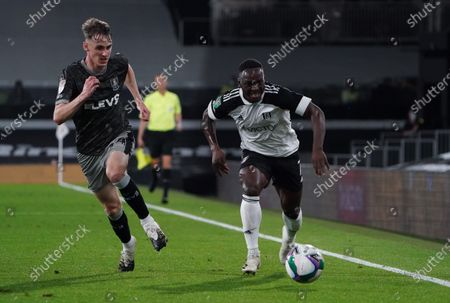 Neeskens Kebano of Fulham and Ciaran Brennan of Sheffield Wednesday